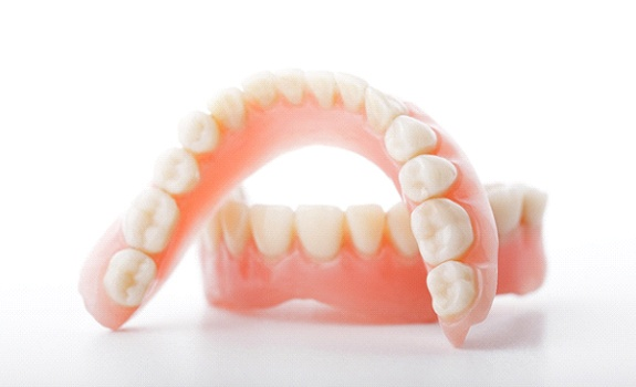Denture in Lakewood with white background