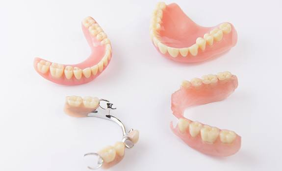 Different types of dentures in Lakewood on white background