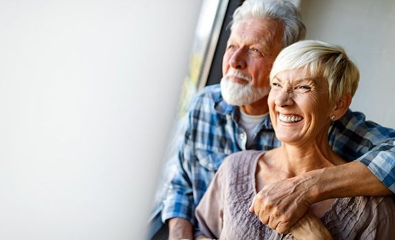 Smiling couple with dentures in Lakewood